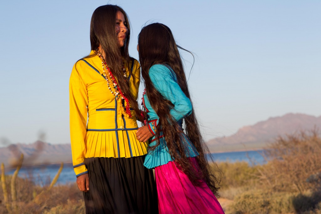 Sisters Mayra and Betsevede, members of the Comcáac indigenous group, dressed in their traditional attire.