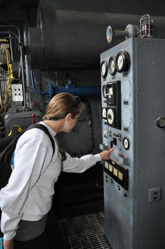 CEM Caitlyn Zimmerman being a rascal, tempted to push buttons on old generators.
