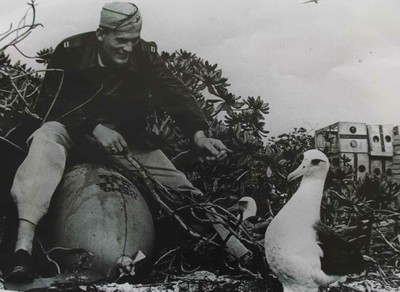 US soldier and Laysan albatross having a moment