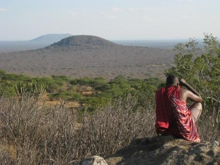 The view from the second beacon with one of the Maasai elders looking over his village with some binoculars