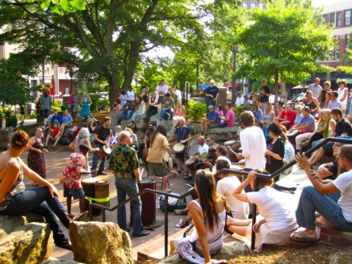 Asheville's annual Friday night musical enchantment, the Drum Circle in Pritchard Park, enthralls hundreds of tourists each month.