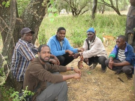Sam and the guys eating the goat at the Maasai market.To the right of Sam is Paolo, Dennis, Seruni (an elder), and one of TPW's Environmetal Scholars.