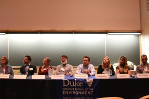 Panelists participate in a wrap-up session panel at the Spring Symposium.