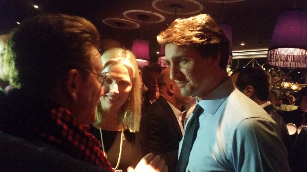Bono chats with Canadian Prime Minister Justin Trudeau.