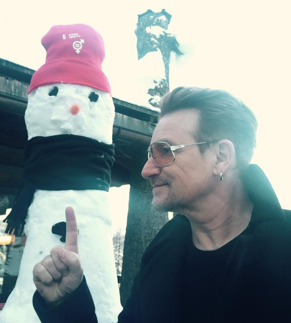 """Snow woman says 'gender equality."" #davos. Photo courtesy of U2's twitter feed."
