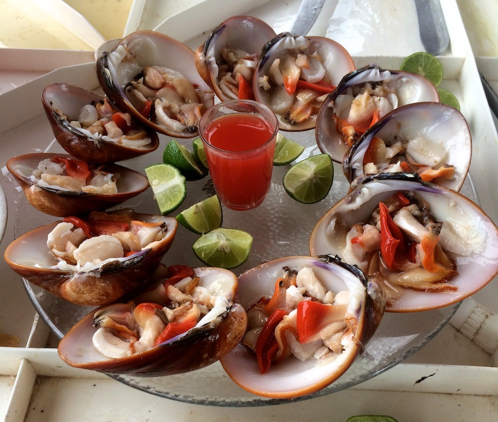 Delicious fresh clams provided by the fishermen with lime and hot sauce