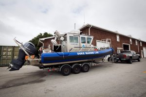 Boats at the Duke Marine Lab being pulled indoors while students and staff evacuated the coastal campus for Hurricane Matthew.