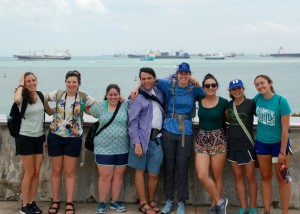 Jess, Aurora, Elisia, Kyle, Emily, Catherine, Savannah, and Izzie from the top of the Marina Barrage with the Singapore port in the back drop.